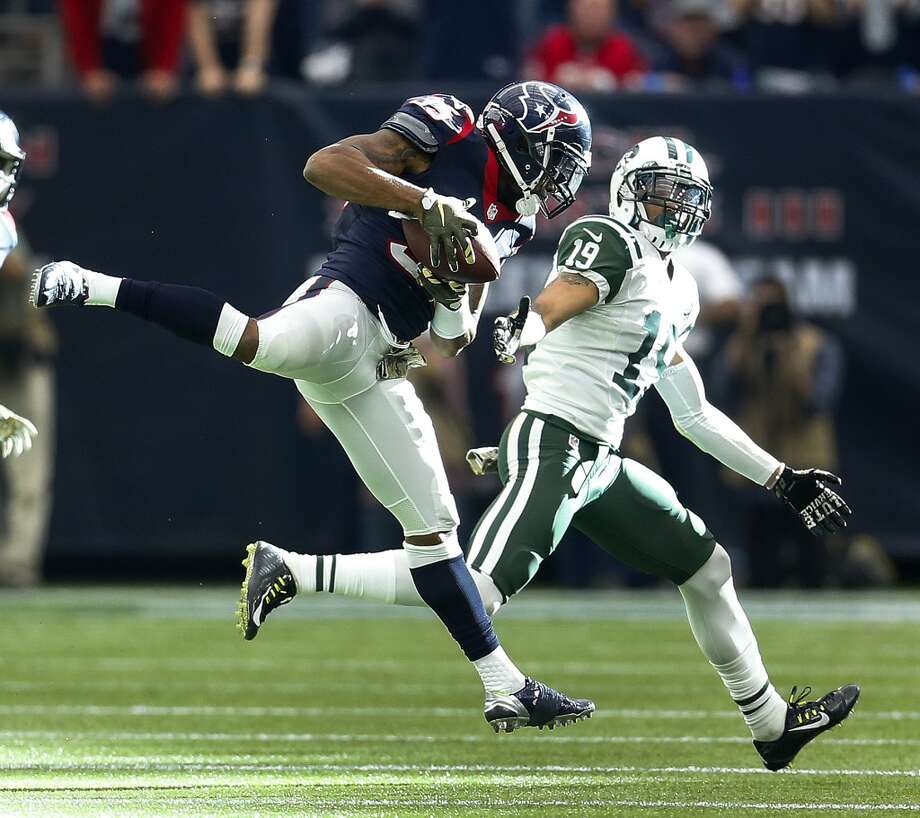 Houston Texans defensive back Eddie Pleasant (35) hauls in an interception on a pass intended for New York Jets wide receiver Devin Smith (19) during the fourth quarter of an NFL football game at NRG Stadium on Sunday, Nov. 22, 2015, in Houston.  ( Karen Warren / Houston Chronicle ) Photo: Karen Warren, Houston Chronicle
