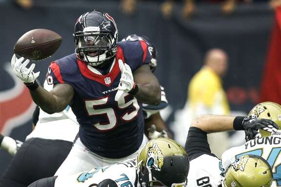 Houston Texans outside linebacker Whitney Mercilus (59) reaches out to catch a fumble forced by J.J. Watt (99) as he sacks Jacksonville Jaguars quarterback Blake Bortles (5) during the fourth quarter of an NFL football game at NRG Stadium on Sunday, Jan. 3, 2016, in Houston. ( Brett Coomer / Houston Chronicle )