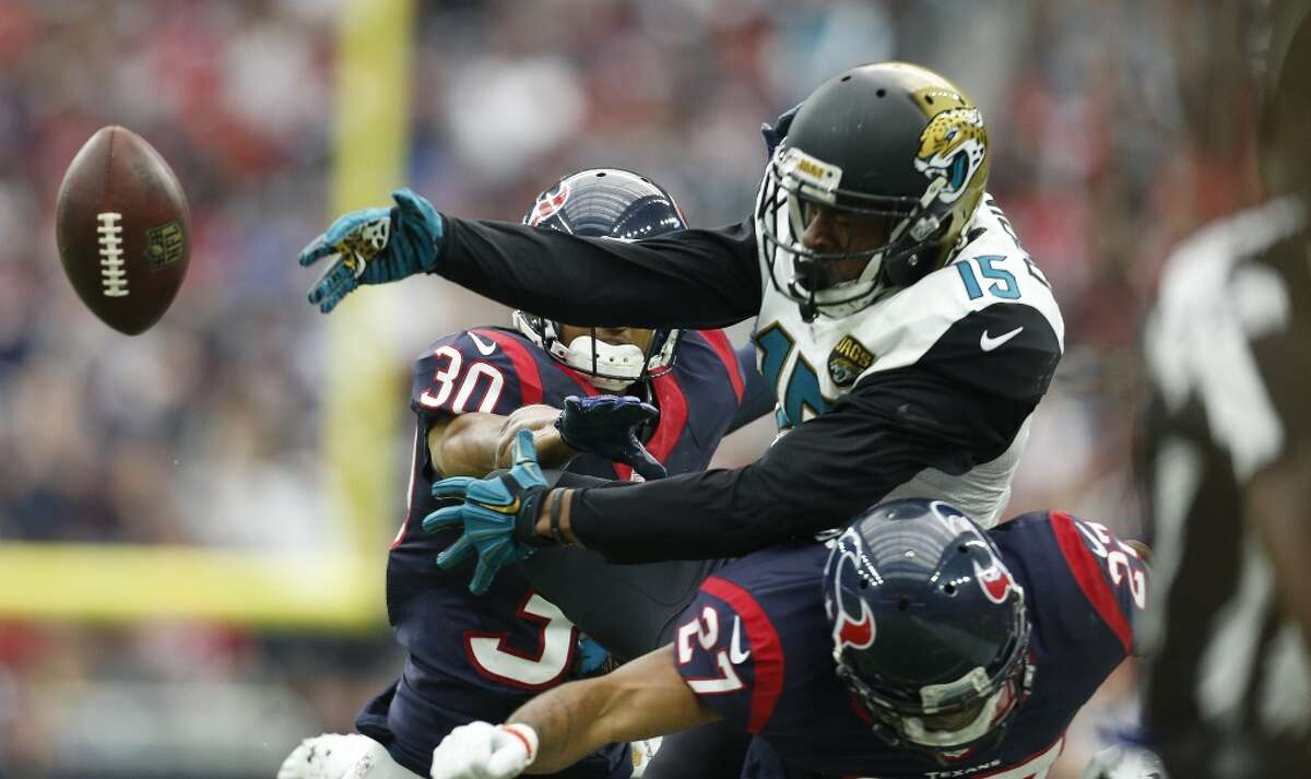 Jacksonville Jaguars wide receiver Allen Robinson (15) reaches for a pass as Houston Texans strong safeys Kevin Johnson (30) and Quintin Demps (27) defended on the play during the second quarter of an NFL football game at NRG Stadium on Sunday, Jan. 3, 2016, in Houston. ( Karen Warren / Houston Chronicle )