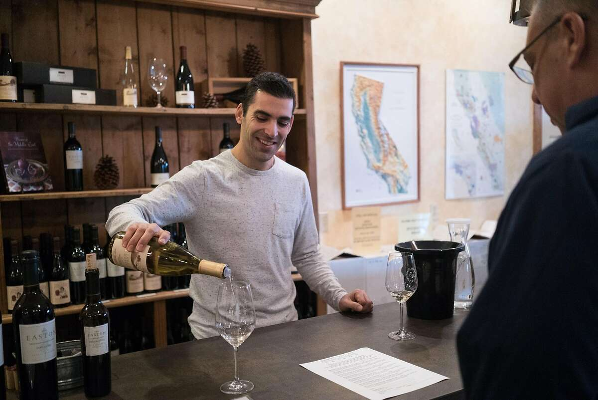 Sergio Abeijon, left, pours a glass of wine for Thomas Allen at Terre Rogue in Plymouth, Calif on Thursday, Jan. 14, 2016. Thomas Allen is a wine buyer for Taste and owner of Fate.