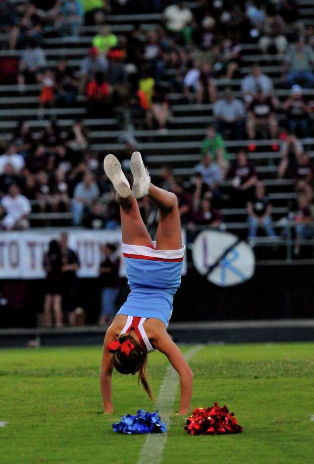 A cheerleader performs at the Silsbee Tigers football game against the Lumberton Tigers on Friday night. Cassie Smith/The Enterprise  Friday, September 13, 2013 Photo: Cassie Smith
