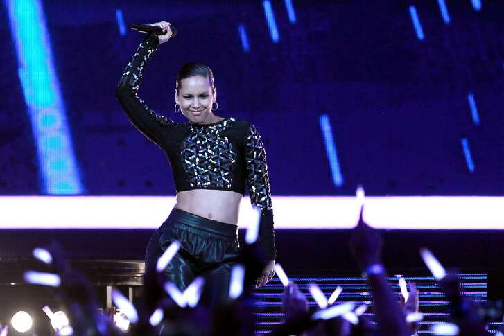 HOUSTON, TX - FEBRUARY 17:  Singer Alicia Keys performs at half time the 2013 NBA All-Star game at the Toyota Center on February 17, 2013 in Houston, Texas. NOTE TO USER: User expressly acknowledges and agrees that, by downloading and or using this photograph, User is consenting to the terms and conditions of the Getty Images License Agreement.  (Photo by Ronald Martinez/Getty Images)