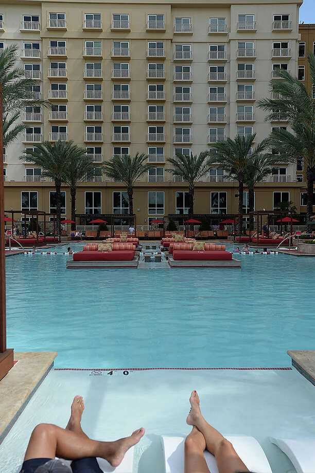 Guests lounge poolside on June 26 at the Golden Nugget Hotel.The Golden Nugget in Lake Charles will add a 300-room hotel tower by the end of this year, the casino resort owner Tilman Fertitta announced Thursday. Photo taken Friday, June 26, 2015 Kim Brent/The Enterprise Photo: Kim Brent / Beaumont Enterprise