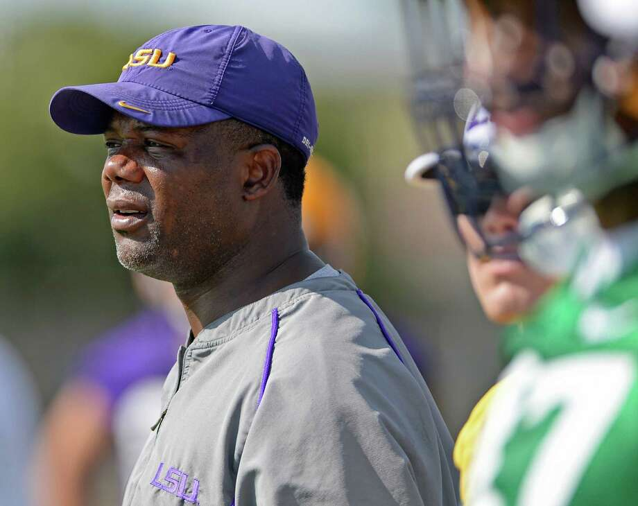 NEW UTSA football coach Frank Wilson works with LSU players during afternoon practice August 7, 2015. Photo: HILARY SCHEINUK, The Advocate / © 2015 The Advocate