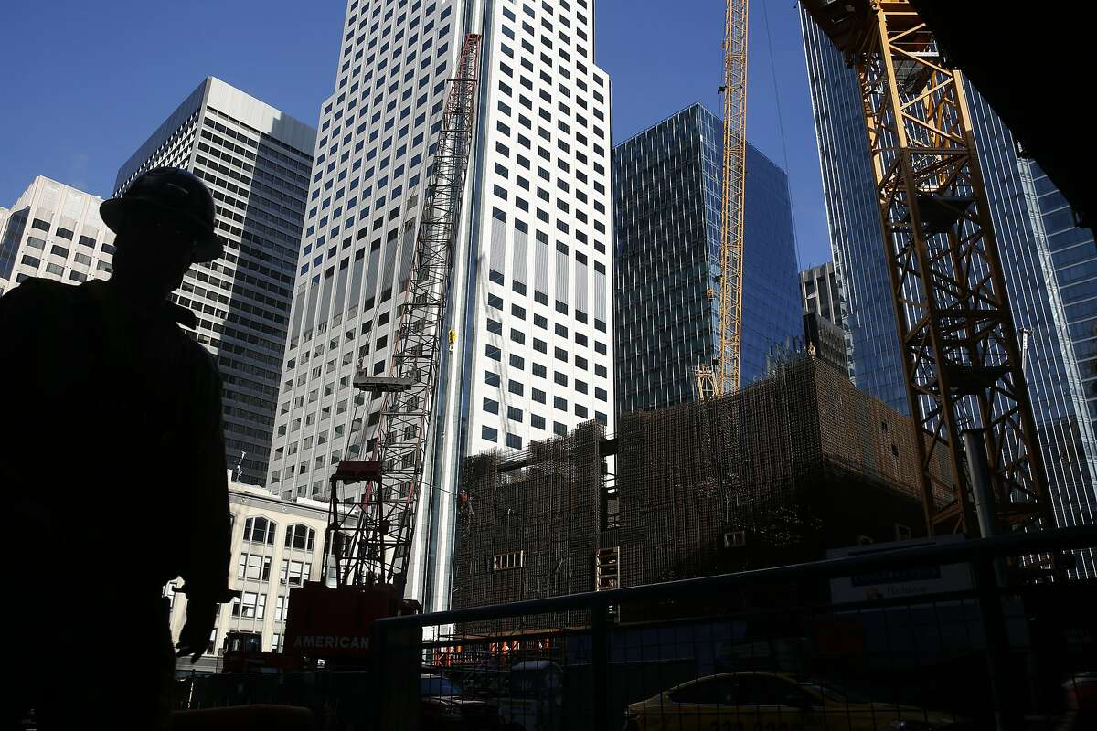 Construction is underway at 1st and Mission Streets Jan. 15, 2015 in downtown San Francisco, Calif.