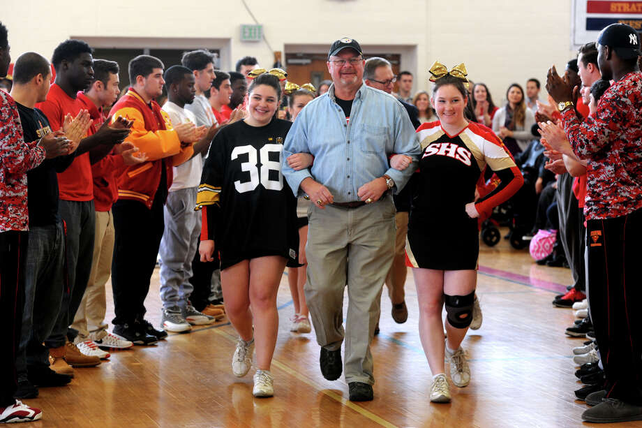 Ed Bradley is escorted by cheerleaders as he is introduced at a pep rally at Stratford High School, in Stratford, Conn. Jan. 15, 2016. The school held the rally to honor both Bradley (Class of 1968) and Nick Giaquinto (Class of 1973), both of who played football at the high school and went on to win Super Bowl Championships in the NFL. Bradley won two championships with the Pittsburg Steelers, and Giaquinto won one playing for the Washington Redskins. Photo: Ned Gerard, Hearst Connecticut Media / Connecticut Post