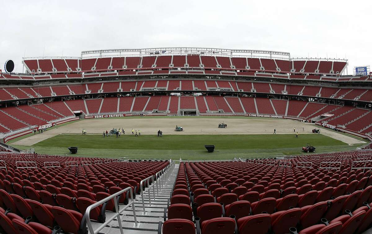 In this photo taken with a fisheye lens, workers install sod on the field at Levi's Stadium in preparation for the NFL's Super Bowl 50 in Santa Clara, Calif., Monday, Jan. 11, 2016. Less than four weeks out from the Super Bowl, the field is nearly ready to be played on thanks to long days at Levi's Stadium by the crew working to install fresh sod and make every necessary tweak in regards to weather and other potential issues.