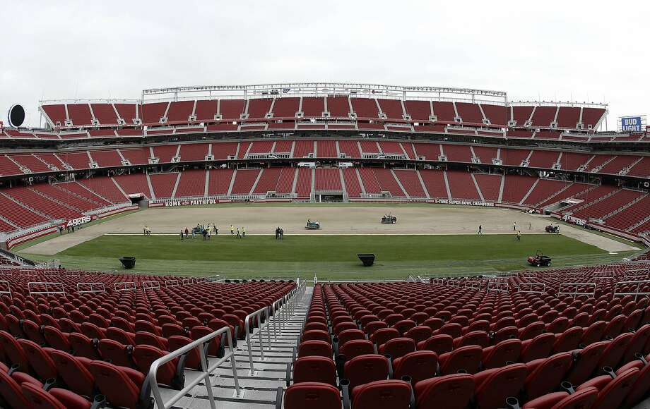 In this photo taken with a fisheye lens, workers install sod on the field at Levi's Stadium in preparation for the NFL's Super Bowl 50 in Santa Clara, Calif., Monday, Jan. 11, 2016. Less than four weeks out from the Super Bowl, the field is nearly ready to be played on thanks to long days at Levi's Stadium by the crew working to install fresh sod and make every necessary tweak in regards to weather and other potential issues. (AP Photo/Jeff Chiu) Photo: Jeff Chiu, Associated Press