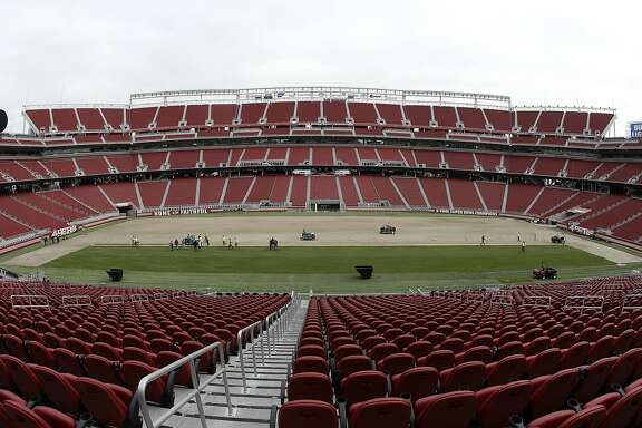 In this photo taken with a fisheye lens, workers install sod on the field at Levi's Stadium in preparation for the NFL's Super Bowl 50 in Santa Clara, Calif., Monday, Jan. 11, 2016. Less than four weeks out from the Super Bowl, the field is nearly ready to be played on thanks to long days at Levi's Stadium by the crew working to install fresh sod and make every necessary tweak in regards to weather and other potential issues. (AP Photo/Jeff Chiu)