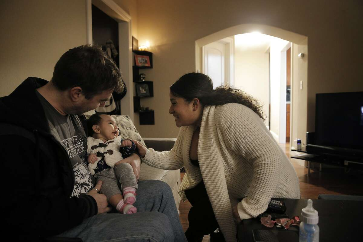 Simon Stahl and his wife Sylvana Stall-Flores and daughter Sascha Stall-Flores in their home in Oakland, Calif., on Wednesday, January 13, 2016. The family has recently moved from San Francisco to Oakland where they found buying a house much more affordable. Sascha was born two weeks before they purchased their home.