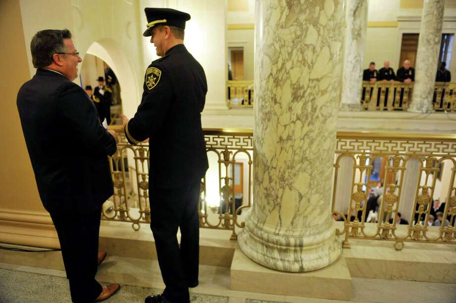 Albany County Executive Dan McCoy, left, and Albany County Sheriff Craig Apple talk prior to the start of the Albany County Inauguration Ceremony at the Albany County Courthouse on Sunday, Jan. 10, 2016, in Albany, N.Y.      (Paul Buckowski / Times Union) Photo: PAUL BUCKOWSKI / 10034933A