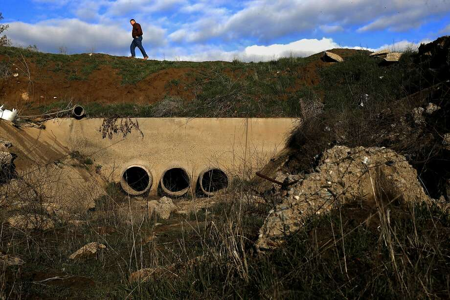 Phil Desatoff, general manager of the Consolidated Irrigation District, walks above a recharge pond. Photo: Michael Macor, The Chronicle