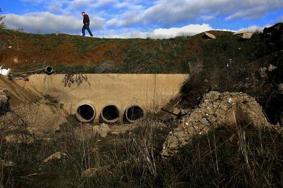 Phil Desatoff, general manager of the Consolidated Irrigation District walks above one of their thirty recharge ponds in Selma, Calif., on Thurs. January 7, 2016. The Consolidation Irrigation District hopes to divert water from the El Nino storms into their recharge ponds throughout the Central Valley to replenish the depleted aquifers.