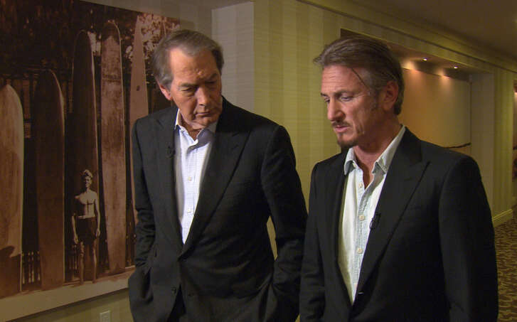 """This Jan. 14, 2016 image released by CBS News/60 Minutes shows Charlie Rose, left, with actor Sean Penn during an interview in Santa Monica, Calif., about Penn's meeting with Mexican drug lord Joaquin """"El Chapo"""" Guzman. The interview will air Sunday on """"60 Minutes."""" (CBS News/60 Minutes via AP) ARCHIVE OUT, NO SALES, NORTH AMERICA USE ONLY."""