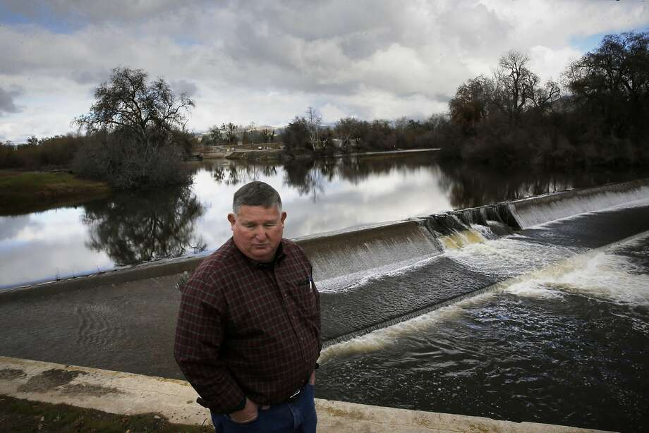 Phil Desatoff, general manager of the Consolidated Irrigation District at the head gate of the Kings River where water is diverted into canals that is used for irrigation near Selma, Calif., as seen on Thurs. January 7, 2016. The Consolidation Irrigation District hopes to divert water from the El Nino storms into their recharge ponds throughout the Central Valley to replenish the depleted aquifers. Photo: Michael Macor, The Chronicle