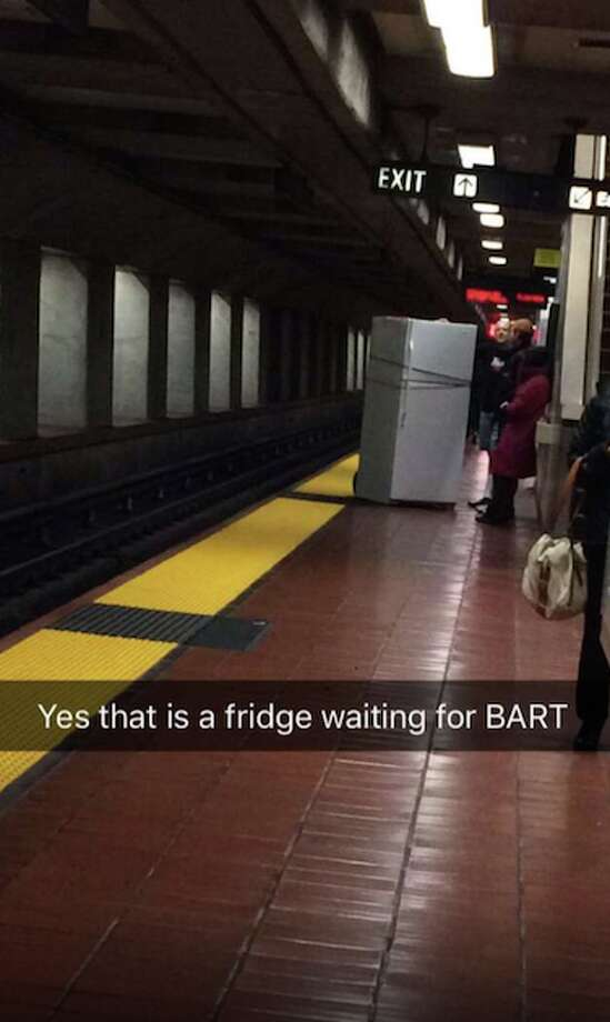 A man waits for a BART train with a fridge at the 19th Street BART station in Oakland on Thursday, Jan. 14, 2016. Photo: Kay Stalk, @kaystalk/Twitter