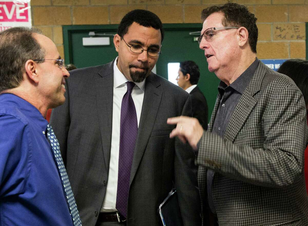 Sharpstown High School principal Robert Gasparello, left, greets, Dr. John King, acting Secretary of Education, center, and HISD Superintendent, Dr. Terry Grier as they arrive to the school on Friday, Jan. 15, 2016, in Houston. King and Mary Wakefield, acting deputy secretary of Health and Human Services, toured the school and then held a roundtable discussion with local leaders, focusing on practical tools and resources available to support communities with linking health and education services for students and their families.