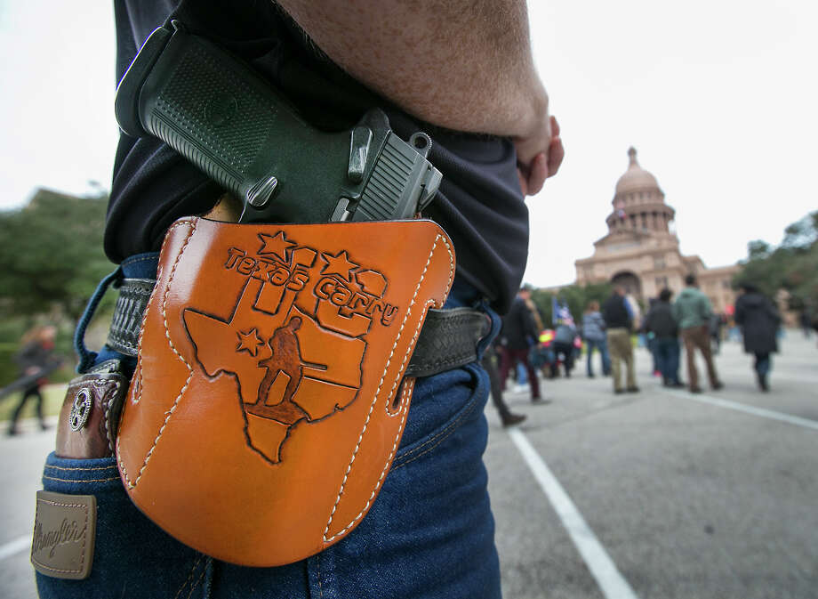 A feeling of safety and protection upon seeing an open toter? Hardly. More like rude, frightening and dangerous. Photo: Ralph Barrera /Austin American-Statesman / Austin American-Statesman