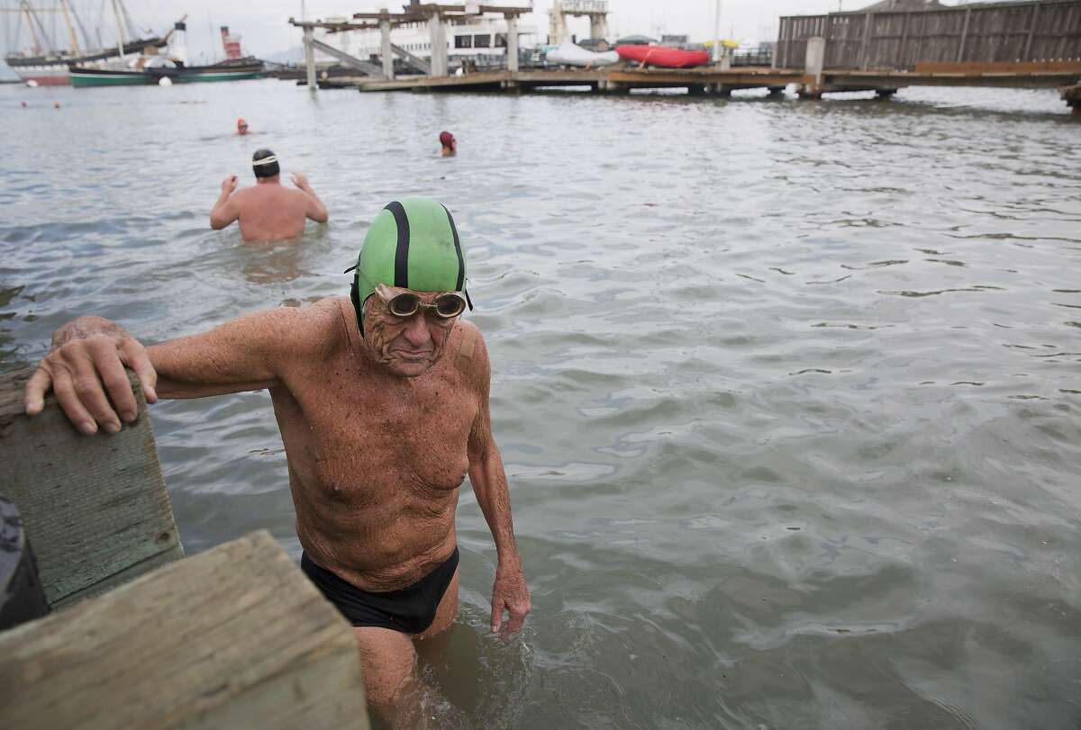 Walt Schneebeli, 90, emerges from the bay at Aquatic Park after a swim with the 'old goats' at the Dolphin Club, the swim club where he's been a member since 1948.