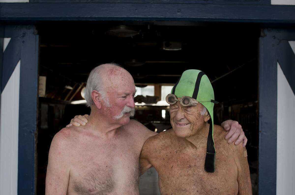 Fellow 'old goats' John Davis and Walt Schneebeli pose for a picture at the Dolphin Club before a swim in the bay.