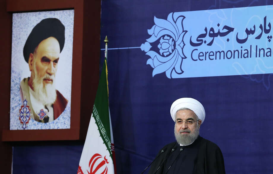 A handout picture provided by the office of Iranian President Hassan Rouhani shows him (R)speaking on Tuesday. Whenever Iran conducts testing on ballistic missiles that are capable of carrying nuclear warheads, its goal is to have the ability to deploy nuclear weapons more reliably and accurately. Photo: HO /AFP / Getty Images / M.Berno