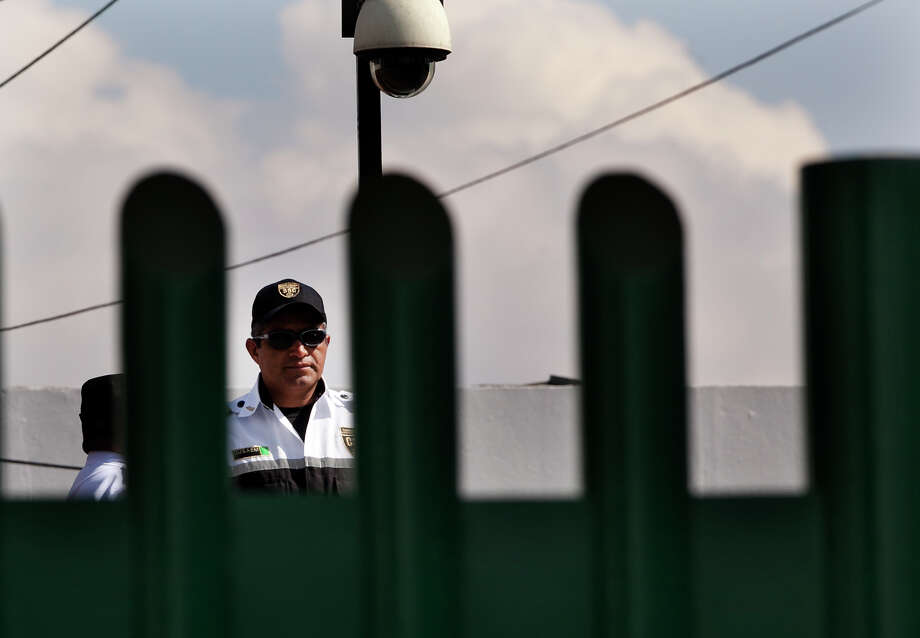A guard stands watch atop a building  where fugitive Ethan Couch is being detained in Iztapalapa, Mexico City.  A reader says the teen avoided jail time because his family could afford first-rate defense attorneys. Photo: Marco Ugarte / Associated Press / AP
