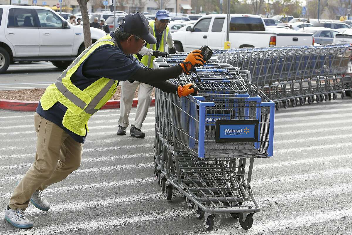 Employee Arnel Almonicar (front) says employees will be taken care of at the Walmart in Oakland, California, on Friday, January 15, 2016. This Walmart will soon be closing this coming Sunday.