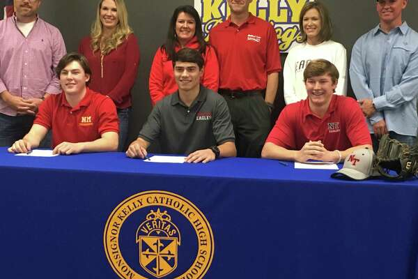 Kelly Catholic's Jake Dickerson (left) Matt Scheurich (center) and Chase Talbot signed their National Letters of Intent Friday.