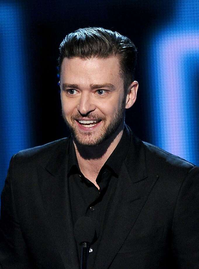 """Singer-actor Justin Timberlake accepts the Favorite Album award for """"The 20/20 Experience"""" onstage at The 40th Annual People's Choice Awards at Nokia Theatre L.A. Live on January 8, 2014 in Los Angeles, California.  (Photo by Kevin Winter/Getty Images) Photo: Kevin Winter, Getty Images"""