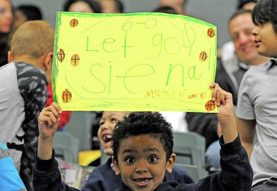 "Second grade student Malachi Merced with the McNulty Academy of Amsterdam cheers on the Siena women's team during their game against Monmouth during ""Kids Day""  at the Alumni Recreation Center on Friday Jan. 15, 2016 in Loudonville, N.Y. (Michael P. Farrell/Times Union) Photo: Michael P. Farrell / 10034982A"