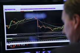 A trader monitors stock prices at the New York Stock Exchange, Friday, Jan. 15, 2016. U.S. stocks plunged again on Friday, completing the worst two-week start to a year ever. (AP Photo/Mark Lennihan)