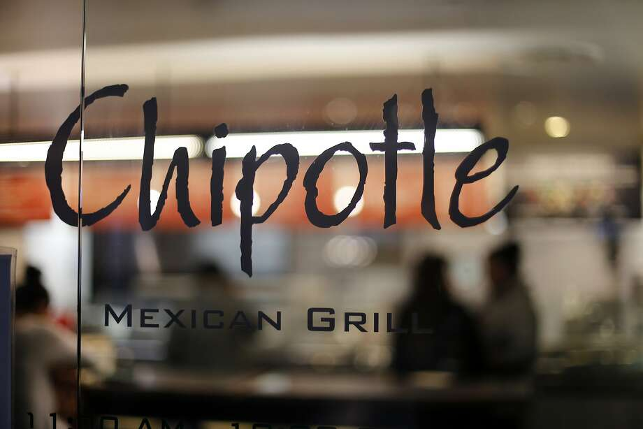 File image of Chipotle Mexican Grill in San Francisco on Feb. 2, 2015. After the E. coli outbreak, Chipotle plans to give away free food as a way to regain customers. Photo: Gene J. Puskar, Associated Press