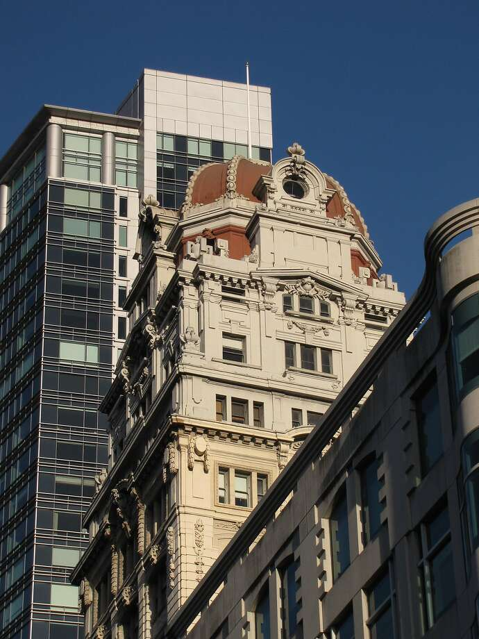 The Humboldt Bank Building from 1906, by Meyer and O'Brien, is a domed 18-story tower at 785 Market St. that's picturesque enough to have survived all the changes around it. Photo: John King, The Chronicle