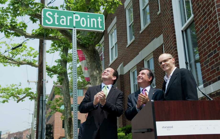 Gov. Dannel P. Malloy, then-Stamford Mayor Michael Pavia and former Starwood Hotels & Resorts CEO Frits van Paasschen commemorate in June 2011 Starwood's headquarters move to Stamford, Conn. from White Plains, N.Y. Photo: File Photo / File Photo / Stamford Advocate File Photo