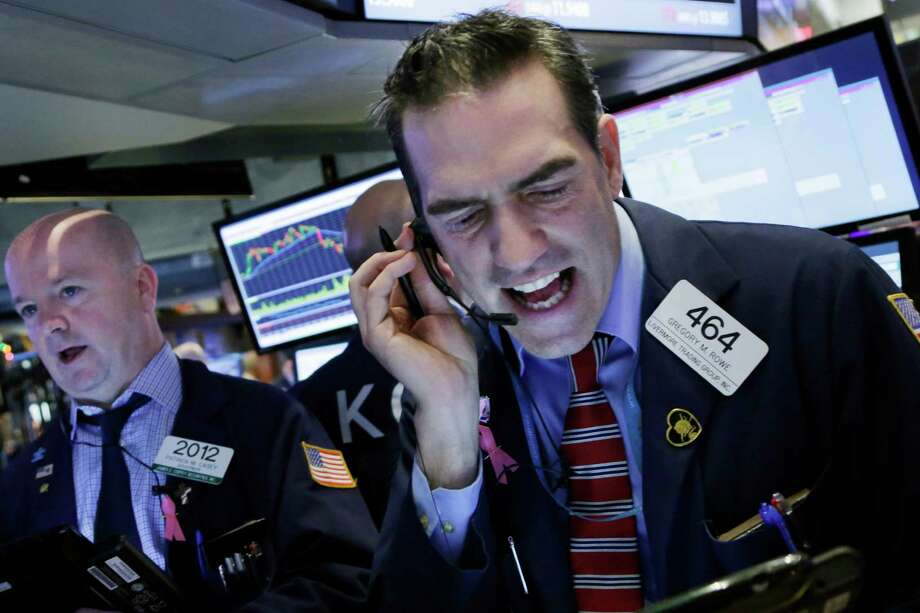 Stock trader Gregory Rowe works at the New York Stock Exchange, Friday, Jan. 15, 2016. (AP Photo/Mark Lennihan) ORG XMIT: NYML105 Photo: Mark Lennihan / AP