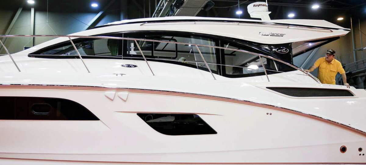 A visitor to the MarineMax display looks toward the bow of the Sea Ray 400 Sundancer at the Houston International Boat, Sport and Travel Show at NRG Center Thursday, Jan. 14, 2016, in Houston.