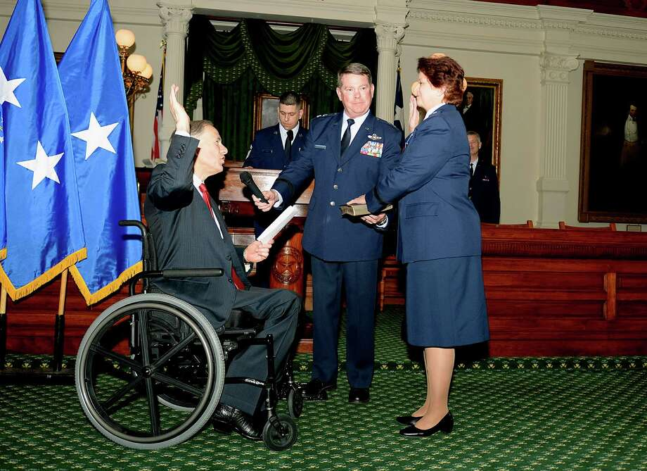Colonel Dawn Ferrell is the first woman Brigadier General in the Texas Air National Guard.  Gov. Greg Abbott gives her oath of office at the Capitol. Photo: Courtesy, 1st Lt. Alicia Lacy