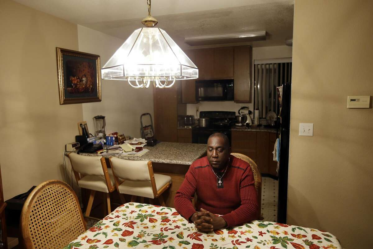 In this Nov. 9, 2015, photo, Pastor Yul Dorn poses for a portrait inside his home, where he's facing eviction due to foreclosure in San Francisco's Bayview-Hunters Point district. As San Francisco rides a massive building boom, fueled largely by growth in tech-based jobs, many African-Americans worry they will not be able to afford to stay in a neighborhood they've long called home. (AP Photo/Marcio Jose Sanchez)
