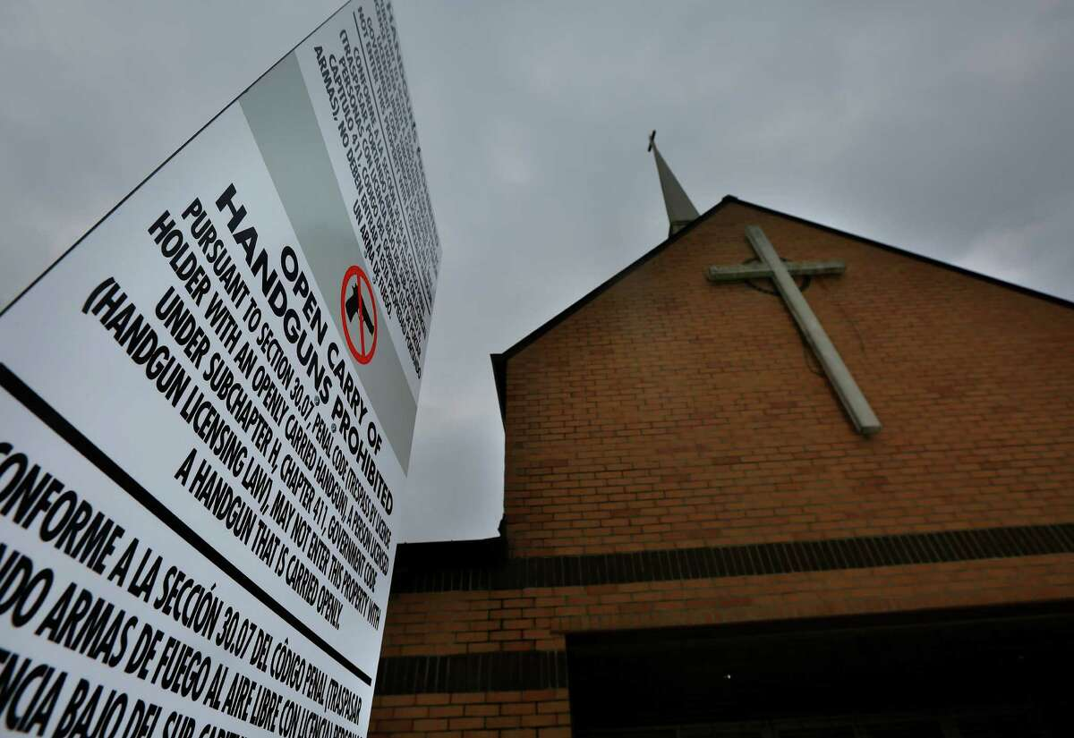 A sign erected in front of the North Main Church of God in Christ in Houston alerts members and visitors that open carry of handguns is prohibited. (Mark Mulligan / Houston Chronicle )