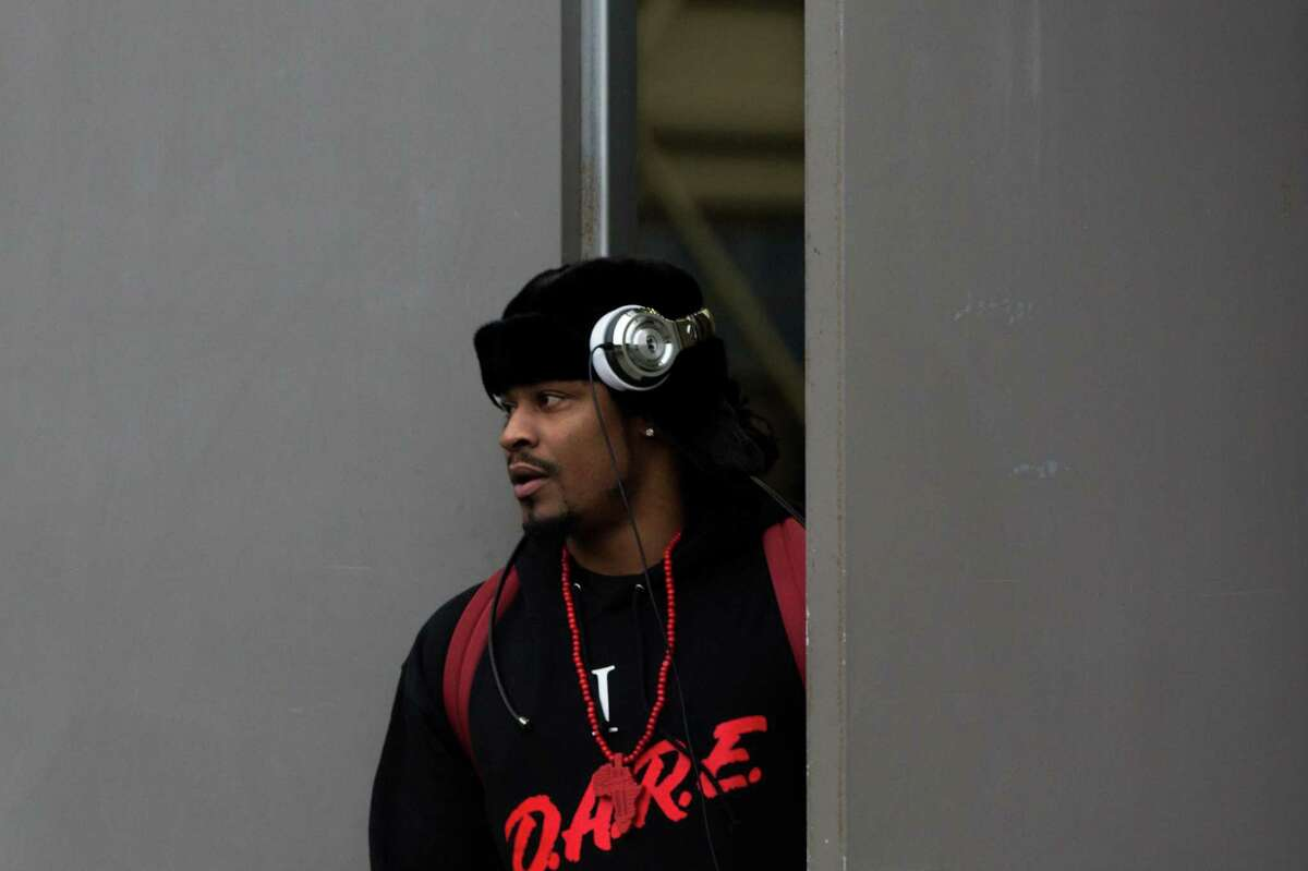 Seahawks running back Marshawn Lynch leaves the Virginia Mason Athletic Center to board the bus to travel to the team's game against the Carolina Panthers, on Friday, Jan. 15, 2016.