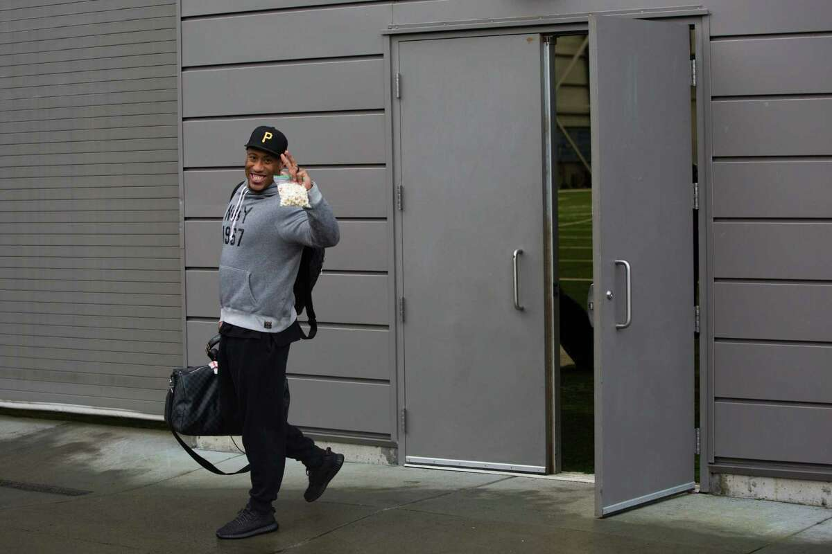 Seahawks linebacker Bruce Irvin waves to the media while getting on the bus to travel to their game against the Carolina Panthers, photographed outside the Virginia Mason Athletic Center in Renton on Friday, Jan. 15, 2016.