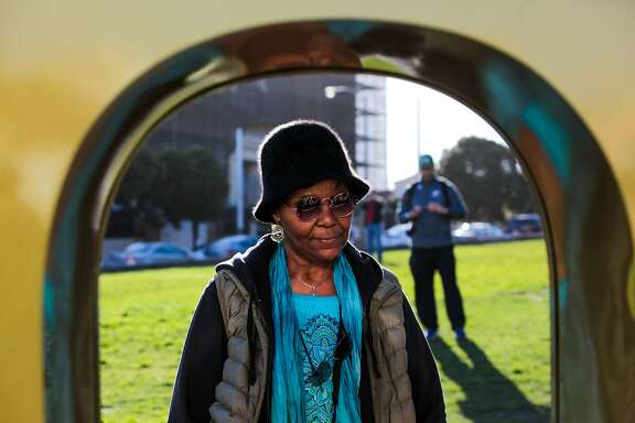 "Shirley Sampson, of Oakland takes a look at a six-foot ""50""  sculpture which was installed as part of the Super Bowl celebration, at Alamo Square Park, in San Francisco, California on Friday, January 15, 2016."