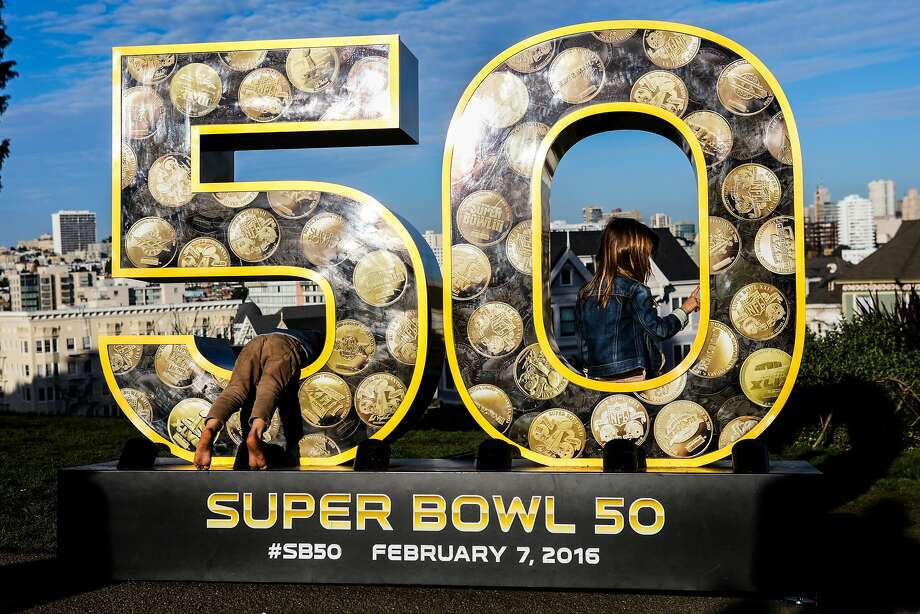 "Ecan Shreve, 3 and Vesper Shreve, 5 climb through a sculpture of the number ""50"", which is one of ten that have been installed across the city for the Super Bowl, in Alamo Square Park, in San Francisco, California on Friday, January 15, 2016. Photo: Gabrielle Lurie, Special To The Chronicle"