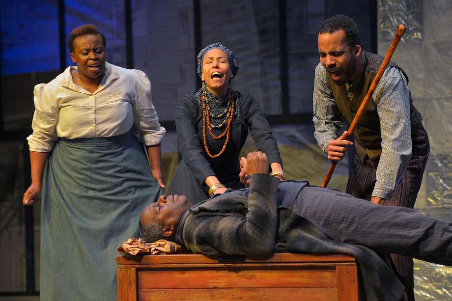 "Black Mary (Omoze Idehenre, left), Aunt Ester (Margo Hall) and Eli (David Everett Moore) anguish over the shooting of Solly Two Kings (Juney Smith) in ""Gem of the Ocean"" at Marin Theatre Company Photo: Kevin Berne"