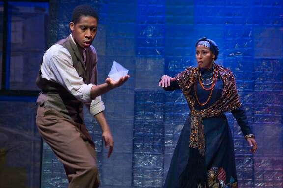 """Aunt Ester (Margo Hall, right) guides Citizen Barlow (Namir Smallwood) toward the City of Bones in """"Gem of the Ocean"""" at Marin Theatre Company"""