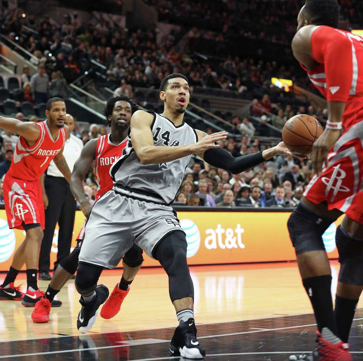 Danny Green passes away after driving to the hoop as the Spurs host the Rockets at the AT&T Center on January 2, 2016.