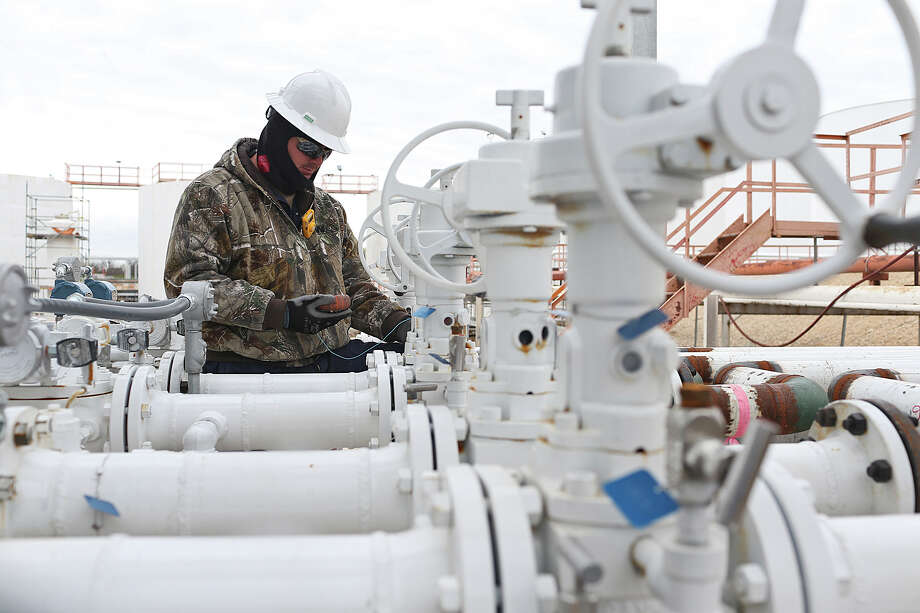 Project supervisor Ryan Watson checks valves at the Calumet Refinery, Monday, Jan. 11, 2016. The refinery has undergone over $200 million in updates that includes new fractionation towers and 18 solvent storage tanks. Photo: Jerry Lara, Staff / San Antonio Express-News / © 2016 San Antonio Express-News