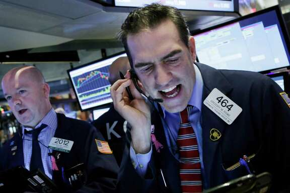 The stock market slid steeply Friday with the Dow Jones Industrial Average down nearly 400 points.