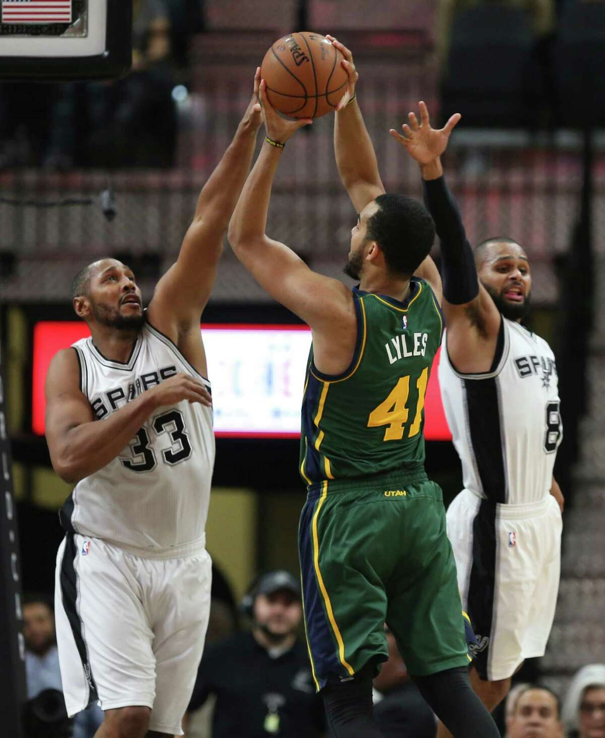 San Antonio Spurs' Boris Diaw, left, and Patty Mills defend against Utah Jazz' Trey Lyles during the second half at the AT&T Center, Wednesday, Jan. 6, 2016. The Spurs won, 123-98.