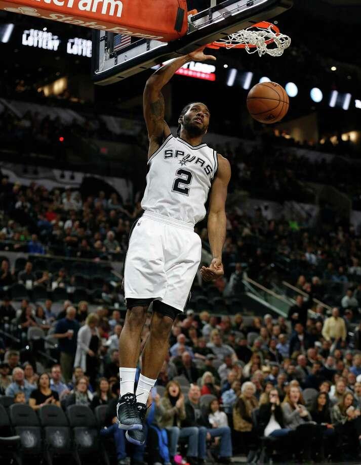 Spurs' Kawhi Leonard (02) gets an easy dunk against the Utah Jazz on Wednesday, Jan. 6, 2016. (Kin Man Hui/San Antonio Express-News) Photo: Kin Man Hui, Staff / San Antonio Express-News / ©2016 San Antonio Express-News